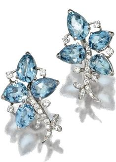 AQUAMARINE AND DIAMOND JEWELRY, CIRCA 1930-1950   The earclips set with 8 pear-shaped aquamarines weighing approximately 12.00 carats further decorated with a meandering vine motif of round, marquise and baguette diamonds, mounted in platinum.