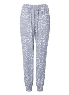 100% Viscose Blue Leopard Pant. Comfortable yet neat fitting silhouette features an elasticised waistband and hem, front yoke, side pockets and dropped crotch in an all over Leopard print. Available in Multi as seen below.