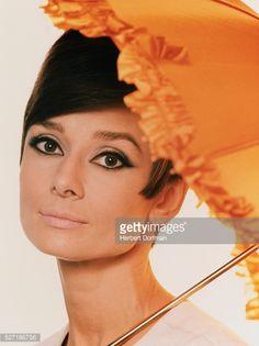 Audrey Hepburn Holding Orange Parasol