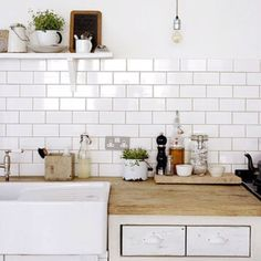 Butcher block and subway tile.  Oh, and a bare Edison bulb!
