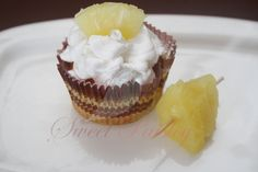 PInacolada cupcake- Coconut cake, pineapple filling,   whipped cream frosting )
