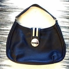 { MICHAEL MICHAEL KORS } Black Shoulder Bag Authentic MICHAEL Michael KORS Black/Cream shoulder bag. A lot of smaller compartments inside. Two tiny smudges on the front, bottom left side (practically unnoticeable, but I zoomed in so you can see). Lovely, practical bag for the Michael Kors lover! reasonable offers accepted no trades MICHAEL Michael Kors Bags Shoulder Bags