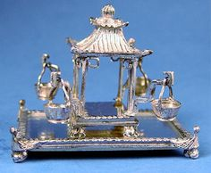 Eugene Kupjack - Pagoda epergne with 4 small baskets With footed mirrored tray, $420