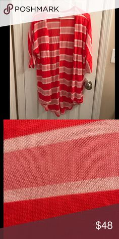 NWT LuLaRoe Lindsay NWT LuLaRoe Lindsay, size small, bright coral, new and with tags. I'm typically a size medium and the small fits me well (even though size chart says xxs-small). LuLaRoe Sweaters