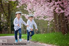Two adorable boys in a cherry blossom garden in spring afternoon by Tatyana Tomsickova on 500px