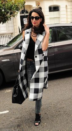 Style departure: Amal Clooney was dressed down in a youthful ensemble as she headed out in...