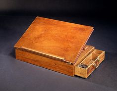 In 1776, Thomas Jefferson wrote the Declaration of Independence on this portable desk. It features a hinged writing board and a locking drawer for papers, pens and inkwell.