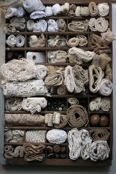 printer's tray filled with lace