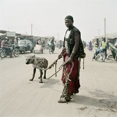 portrait, power, control, wild  |  by Pieter Hugo.   Mallam Mantari Lamal with Mainasara, Nigeria 2005
