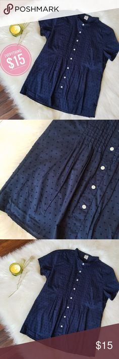 J.Crew Navy Pintuck Button Down ADORABLE button down blouse from J.Crew. Its is rich navy blue. It starts at the top with a small collar, a pintuck bib, and buttons all the way down. The fabric is embroidered with navy polka dots.  Condition: EUC Retail: $78 Size: XS   Make an offer or add to a bundle for a private offer! #28 J. Crew Factory Tops Button Down Shirts