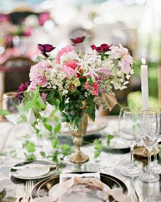 The table settings evoked classic still-life paintings with centerpieces of loose, lush florals.