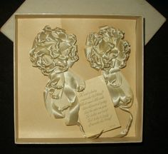 From the Edwardian to 1920's era, a boxed set of baby bonnet ribbon rosettes from the Boag Ribbon Company.  A sweet gift card was also included with the embellishments