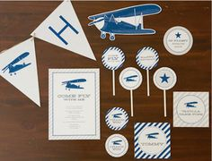 Vintage Airplane Birthday Party Free Printable -From invitations to favor tags, cupcake toppers and a happy birthday banner by The TomKat Studio for Pottery Barn