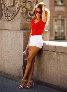 Red top, white shorts  high heels :-)