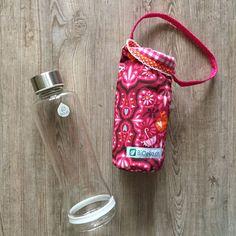 Glasflasche mit Stoffhuelle