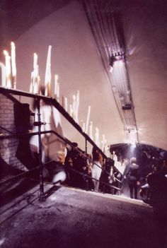 Maison Martin Margiela Spring/Summer 1992 show in Saint-Martin metro station.  The station had been out of use since 1939. For the show, 1600 candles illuminated the tree main stairwells.