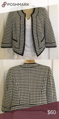 White House Black Market Blazer Black and white blazer with black trim. Polyester lining. Hook and eye closure at the waist. White House Black Market Jackets & Coats Blazers