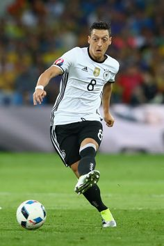 Mesut Ozil of Germany runs with the ball during the UEFA EURO 2016 Group C match between Germany and Ukraine at Stade Pierre-Mauroy on June 12, 2016 in Lille, France.