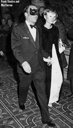"""{The Black & White Ball} Singer and actor Frank Sinatra and his wife actress Mia Farrow photographed during the """"Black and White Ball"""" legendary masked ball organized by the writer Truman Capote in Grand Ballroom of New York City's Plaza Hotel. NY, November 28, 1966. -Mia was wearing a creation by Givenchy."""