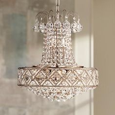 Bold and sophisticated, this clear crystal chandelier instantly dresses up your decor. Eight candelabra bulbs offer warm ambience and make this lighting fixture sparkle when illuminated.