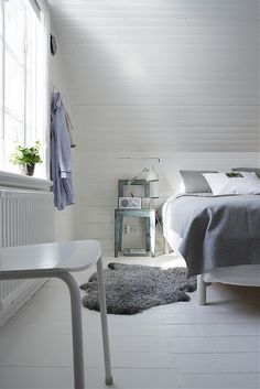 Attic bedroom - love the brightness of the room, very light colours!