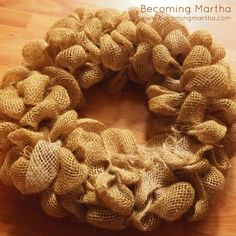 A fall wreath created with bubbled burlap, a monogram, and a vine of fake leaves. Full tutorial included with bubbling technique.