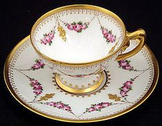 Porcelain demitasse cup and saucer was produced in Germany by H. Wolfsohn Dresden before 1900.