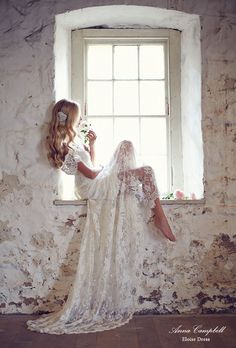 Anna Campbell wedding dresses. LOVE everything about this. Her hair, the broach, and the lace gown! <3