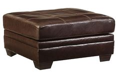 The Beenison Ottoman from Ashley Furniture HomeStore (AFHS.com). Upholstery features top-grain leather in the seating areas with skillfully matched DuraBlend® upholstery everywhere else.