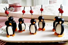 Olive, cream cheese, and carrot penguins. Too bad I don't like olives. Love penguins though :)