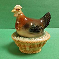 A sweet vintage ceramic/porcelain chicken or hen on nest salt and pepper…