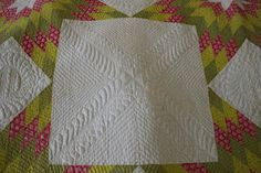 The hand quilting won  me over.