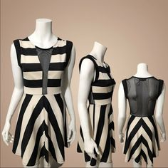 """Ellie Make A Mesh Striped Dress Chic striped dress with front and back sheer mesh. Scoop Neck. Sleeveless. Fabric has a bit of stretch. Pullover styling. Approx. total length 33"""". Waist 28"""" (stretched). Pit to pit 16.5"""". 90% polyester, 10% spandex. Made with love in the USA Dresses"""