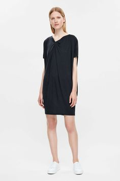Designed to fall loosely on the body, this dress has gathers on the neckline for a softly draped front. Made from lightweight cotton-mix jersey with a slight stretch, it is a wide A-line shape with kimono sleeves and neat stitched edges.