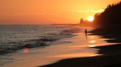 A walk on the beach at sunset is a great way to relax.