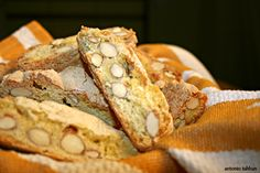 Authentic Italian Almond Biscotti alle Mandorle by Tony Sahan - good base for a dry tea biscuit. 275 g flour, approx 2 cups 225 g granulated sugar, approx 1 cup + 2 tbsp zest of 2-3 lemons 1 tsp. baking powder pinch of salt 1 tsp anise, ground (optional) 200 g raw almonds, approx 1 1/3 cups 3 eggs