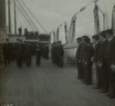 Life on ship: Captain Smith is seen walking along the deck with senior members of his crew on board the RMS Adriatic
