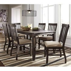 The gorgeous Ashley Dresbar 7 Piece Dining Set is a perfect example of rustic farmhouse style. Set includes table and 6 chairs. Gray/brown vintage wire-brushed finish on acacia veneer and hardwood. Dining height seats covered in soft cream fabric. Dresbar 7 Pc. Dining Set   Weekends Only Furniture and Mattress