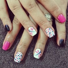 Pink and navy nails with dragonfly and dots