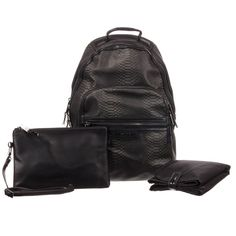 Baby changing bag byTIBA + MARL, designed as a backpack to allow for extra clothing and baby essentials. Black, with a stylish imitation snakeskin on the outside and a practical wipe clean lining on the inside. The main compartment fastens with a zip and there are various pockets and pouches, including an insulatedbottle pouch. It comes with a folding changing mat and a smaller clutch bag. The clutch bag has a detachable strap, so can also be worn as a cross body bag. Baby Changing Bags, Changing Mat, Clutch Bag, Crossbody Bag, Baby Essentials, Chester, Pouches, Fashion Bags, Cross Body