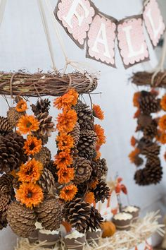 I kinda like pine cones mixed with flowers, but maybe sunflowers instead.