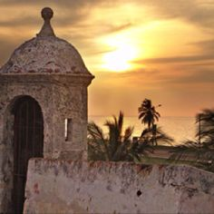A fortress ruin in Cartagena, Colombia sparks the writer's interest.  One generation's prison is another generation's travel attraction!  Sunsets and palm trees, a massage for my soul, might not have been so calming to one imprisoned here in times gone by.