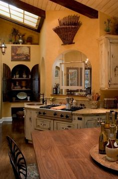 French Country Kitchen And Tuscan Kitchen:   A French Country Kitchen embodies warmth, fine art, wonderful wine, delectable food, beautiful beaches, and rustic countryside vistas are all affectionately associated with Tuscany Italy. A true Tuscan kitchen has roughly plastered walls. I would have tile floors (a rustic tile)!