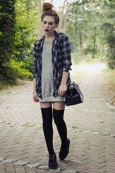 over the knee socks, slouchy sweater and a plaid shirt - messy top bun, ect..fun grunge inspired look.