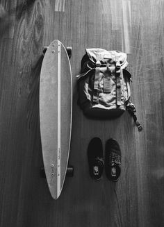 Vans shoes. Longboard. Vans backpack.