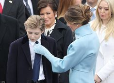 While waiting for his father's big event, Barron Trump was spotted next to his mother Melania as she fixed his tie during the inauguration ceremony