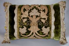 Moss green silk velvet pillow with gold and silver embroidery and purl work, English or French, 17th C. Couched silver and gold metal raised embroidery on the original green silk velvet. Appliques of leaves were cut from woven cloths of gold and silver and applied to cut pile silk velvet then outlined with gold metal cording. Raised areas were stuffed with padding and covered with cloths of gold giving this remarkable textile a three dimensional quality. Areas of thick metal purl can be…