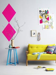 Love The Bright Yellow Sofa Blue Side Table And Neon Pink Wall Decals In This Living Room