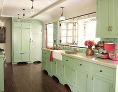 colorful-kitchen-cabinets.jpg - cream and 20's mint green. large windows over sink open wide, too!