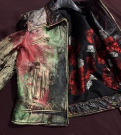 Distressed leather jacket for woman size M   Hand painted and Distressed on some parts. One of a kind  Red roses lining.